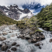 The whitewater of Rio del Frances against the mountain peaks in Torres del Paine National Park in Patagonia, Chile.