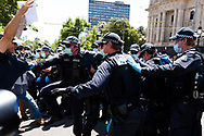 Riot police arrest a man during the Melbourne Freedom Rally at Parliament House. Police move into position on the steps of state parliament ahead of a planed protest. The groups who have organised the many Freedom Day protests over the last 3 months, attempted to march on State Parliament during Melbourne Cup Day demanding the sacking of Premier Daniel Andrews for the lockdown and attacks on their civil liberties. Police met with the protester's with significant force despite the city having had zero cases for five days. (Photo by Dave Hewison/Speed Media)
