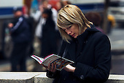 USA, NY, New york city, Manhattan, A female tourist looking at a NY guidebook