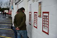 Fans collect tickets during the The FA Cup 2nd round match between Swindon Town and Woking at the County Ground, Swindon, England on 2 December 2018.