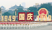 A marching band marches through Tiananmen Square as China celebrates its 50th anniversary with a massive parade in Beijing October 1, 1999.