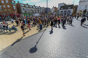 People wearing face protective masks are gathered in Market Square, in Dover on Saturday, Sept 5, 2020 - after fears of violence against the refugees announced by far-right groups who are expected to assemble to demonstrate over migrant crossings. Pro-migrant protesters are already gathered in the town on Saturday amid a heavy police presence. Dover MP Natalie Elphicke has urged people to stay away from the protests given the backdrop of the Covid-19 pandemic. British media reports say that on Friday, an activist group projected pro-immigrant messages onto the White Cliffs of Dover ahead of the protests saying 'Rise above fear. Refugees welcome' (VXP Photo/ Vudi Xhymshiti)