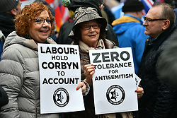 © Licensed to London News Pictures. 08/04/2018. London, UK. A heavy police presence as Campaigners against anti-semitism demonstrate outside the headquarters of the Labour Party, in London over the handling of recent claims of anti-semitism by the party and it's leader Jeremy Corbyn. Labour party leader Jeremy Corbyn recently apologised for what he described as 'pockets' of anti-Semitism within Labour Party. Photo credit: Ben Cawthra/LNP
