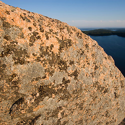 A lichen-covered boulder on the summit of South Bubble Mountain in Maine's Acadia National Park.