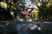 Rio Quente_GO, Brasil.<br /> <br /> Camping Esplanada, onde fica o unico rio de aguas quentes do mundo, manancial hidrotermal a ceu aberto que possui sua nascente na serra de Caldas.<br /> <br />  Esplanada camping, which is the only river of warm waters in the world in open sky that has its source in the Serra de Caldas.<br /> <br /> Foto: MARCUS DESIMONI / NITRO