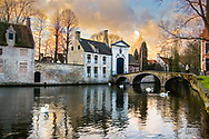 """Late afternoon winter photograph of the romantic """"lake of love"""" known as the Minnewater in Brugge, Belgium"""
