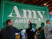 02 FEBRUARY 2020 - JOHNSTON, IOWA: Amy Klobuchar's advance team puts up her stage before a Super Bowl party hosted by the Klobuchar campaign at a barbecue restaurant in Johnston, a suburb of Des Moines. Sen. Klobuchar campaigned to support her candidacy for the US Presidency Sunday in Iowa. She is trying to capitalize on her recent uptick in national polls. Iowa holds the first selection event of the presidential election cycle. The Iowa Caucuses are Feb. 3, 2020.          PHOTO BY JACK KURTZ