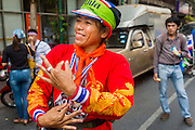 01 FEBRUARY 2014 - BANGKOK, THAILAND: Anti-government protestors dance to Thai country music in the Chinatown section of Bangkok. The anti-government protest movement, led by the People's Democratic Reform Committee (PDRC) organized a march through the Chinatown district of Bangkok Saturday and disrupted the city's famous Chinese New Year festival. Some streets were blocked and protest leader Suthep Thaugsuban walked through the neighborhood collecting money. Suthep and other protestors wore red Saturday in honor of Chinese New Year. Normally the anti-government protestors wear yellow (the color of the King) or anything but red, which is the color worn by the Red Shirts. The march was in advance of massive protests the PDRC has promised for Sunday, Feb. 2 in an effort to block Thais from voting in the national election.     PHOTO BY JACK KURTZ