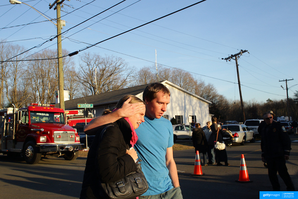 Unidentified people leaving the fire station in Sandy Hook after today's shootings at Sandy Hook Elementary School, Newtown, Connecticut, USA. 14th December 2012. Photo Tim Clayton