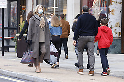 © Licensed to London News Pictures. 15/12/2020. London, UK.  Christmas shoppers walk along Regent Street in London's West End. London and other areas of the south east are to enter tier three restrictions at midnight tonight as Covid-19 infection rates rise. Photo credit: Peter Macdiarmid/LNP