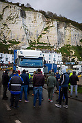 Truck drivers blockade a lorry leaving the port as tensions are high between police and drivers who have been waiting over 48 hours for the Port of Dover to re-open, on the 23rd of December 2020, Dover, Kent, United Kingdom. The French border was closed due to a new strain of COVID-19 all travellers are now waiting to receive a COVID-19 test before they can board a ferry to Calais, France. Dover is the nearest port to France with just 34 kilometres (21 miles) between them. It is one of the busiest ports in the world. As well as freight container ships it is also the main port for P&O and DFDS Seaways ferries.  (photo by Andrew Aitchison / In pictures via Getty Images)