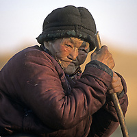 MONGOLIA. Clan matriarch outside her ger<br />  (yurt) in the Darhad Valley.