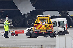 © Licensed to London News Pictures. 14/02/2018. London, UK. Police recreate the position of two vehicles (L) that crashed killing a British Airways employee on the tarmac at Heathrow Airport after this morning's fatal crash near Terminal 5. Photo credit: Peter Macdiarmid/LNP