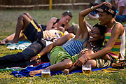 A couple relax and enjoy the sounds from the Lake of Stars music festival in  Chinteche town , Malawi.