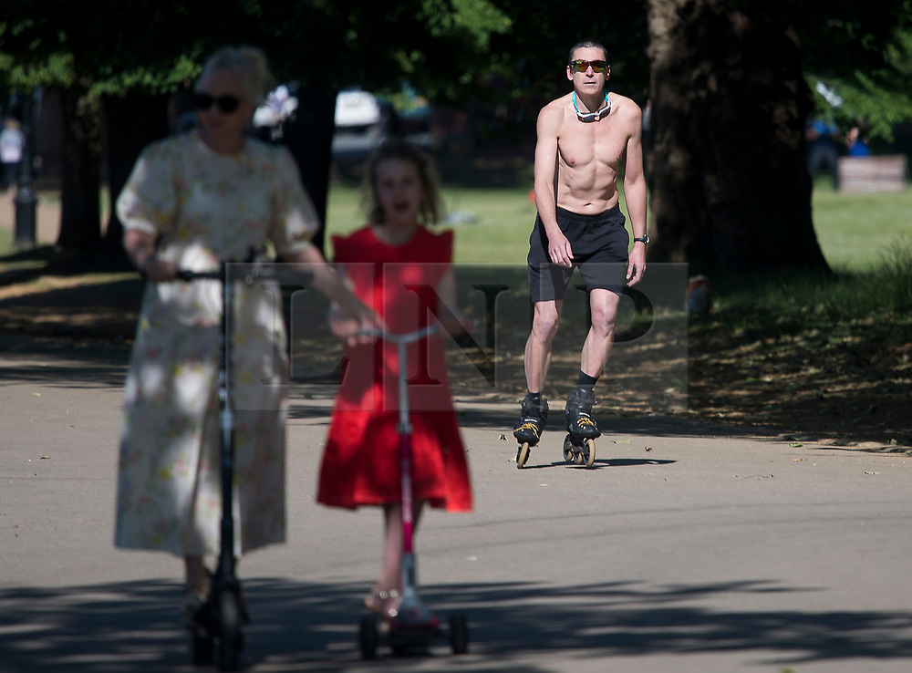 © Licensed to London News Pictures. 13/06/2021. London, UK. A man rollerblading in the early morning warm weather in Hyde Park central London on a hot summer's day. Temperatures in the capital are expected to reach a high for the year. Photo credit: Ben Cawthra/LNP