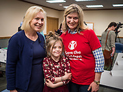 """24 MAY 2019 - WEST DES MOINES, IOWA: US Senator KIRSTEN GILLIBRAND (D-NY), left, talks to JEN STATLER, right, and her granddaughter, MYLAH STATLER, 7, after Gillibrand's forum on family rights in the West Des Moines Public Library. Gillibrand unveiled her """"Family Bill of Rights"""" during a forum in West Des Moines. The New York Senator has made family health and rights a centerpiece of her campaign. She is touring Iowa this week to support her candidacy to be the Democratic nominee for the US Presidency. Iowa traditionally hosts the the first selection event of the presidential election cycle. The Iowa Caucuses will be on Feb. 3, 2020.           PHOTO BY JACK KURTZ"""
