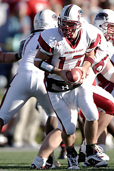 14 October 2006: Nick Hill takes the snap and looks for a back. The 6th largest crowd at Hancock Stadium came to watch a game that put 8th ranked Southern Illinois Salukis against 5th ranked Illinois State University Redbirds.  The Redbirds stole the show for a Homecoming win by a score of 37 - 10. Competition commenced at Hancock Stadium on the campus of Illinois State University in Normal Illinois.<br />