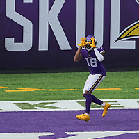 MINNEAPOLIS, MN - SEPTEMBER 27: Justin Jefferson #18 of the Minnesota Vikings scores a touchdown against the Tennessee Titans in the third quarter at U.S. Bank Stadium on September 27, 2020 in Minneapolis, Minnesota. (Photo by Adam Bettcher/Getty Images) *** Local Caption *** Justin Jefferson