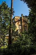 A building in ruins seen from inside the Biologic garden in Lisbon, Portugal.