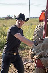 rugged mature cowboy on a ranch