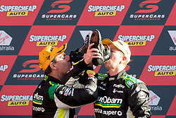 October 8, 2018 - Bathurst, NSW, U.S. - BATHURST, NSW - OCTOBER 07: Race Winners Craig Lowndes / Steven Richards in the Autobarn Lowndes Racing Holden Commodore preform a ''shoey'' on the podium at the Supercheap Auto Bathurst 1000 V8 Supercar Race at Mount Panorama Circuit in Bathurst, Australia on October 07, 2018 (Photo by Speed Media/Icon Sportswire) (Credit Image: © Speed Media/Icon SMI via ZUMA Press)