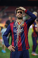 Barcelona´s Pique celebrates after winning the 2014-15 Copa del Rey final match against Athletic de Bilbao at Camp Nou stadium in Barcelona, Spain. May 30, 2015. (ALTERPHOTOS/Victor Blanco)