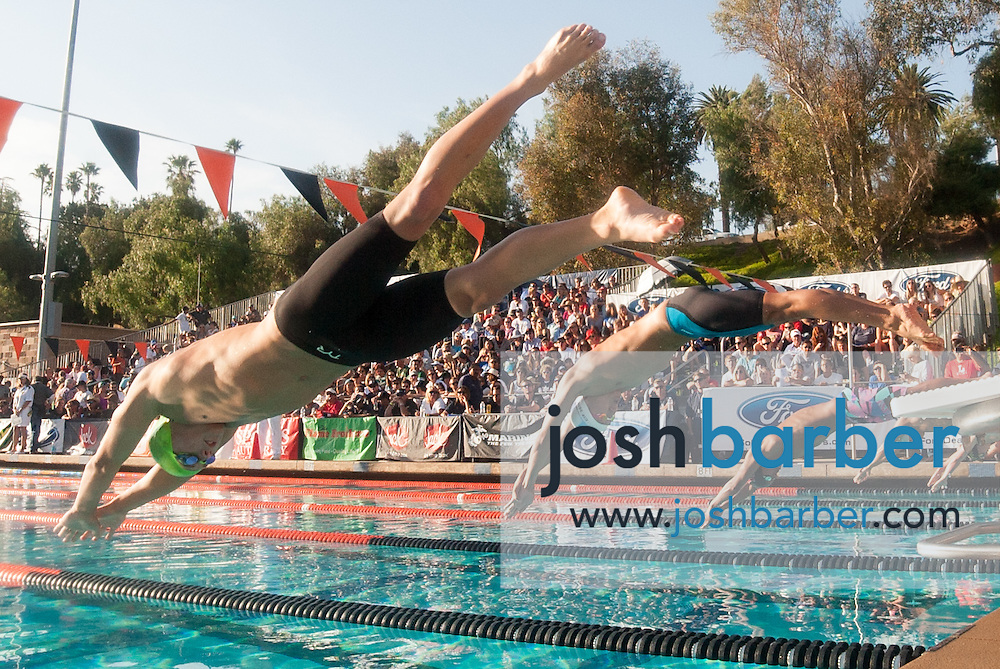 Dana Hills Jack McLaughlin competes in the boys 100-yard butterfly consolation during the CIF-SS Division 1 Swimming Finals at Riverside City College on Saturday.