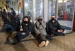 "© Licensed to London News Pictures;30/03/2021; Bristol, UK. Protesters stage a sit down protest in front of Bridewell Police Station as a fourth ""Kill the Bill"" protest in Bristol this week takes place against the Police, Crime, Sentencing and Courts Bill during the Covid-19 coronavirus pandemic in England. The Bill proposes new restrictions on protests. Lockdown restrictions have been partly lifted to allow people to gather outdoors socially in households, bubbles, or to meet one person from another household, but the police say protests are not allowed under the current Covid regulations. Photo credit: Simon Chapman/LNP."