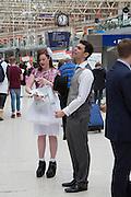 LAURA COLSTON, Royal Ascot racegoers at Waterloo station. London. 20 June 2013.