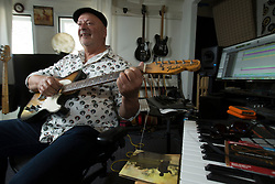 Greg Landau, a composer, musician and producer, poses for a photograph in his home production studio, Wednesday, Nov. 1, 2017 in Alameda, Calif. (Photo by D. Ross Cameron)