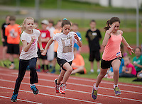 Katie Allen (ESS) Senka Sevegjarto (PSS) and Destiny Medici (WHS) compete in the 100 meter during the 5th grade track meet on Smith Track at Opechee Park Wednesday morning.  (Karen Bobotas/for the Laconia Daily Sun)
