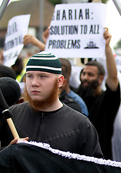 © Licensed to London News Pictures. FILE PICTURE DATED 30/07/2011.  London, UK. Muslim Convert, Jamal ud-Din (wearing green and white striped wool hat with ginger beard )  taking part in a Muslims Against Crusaders march through Waltham Forest in East London. Jamal ud-Din is understood to be one of two people arrested on suspicion of plotting an attack against the London 2012 Olympic Games canoeing venue in East London . Photo credit : Joel Goodman/LNP