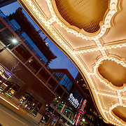 Under the lit-up marquee at the Midland Theatre on Main Street in downtown Kansas City, Missouri.