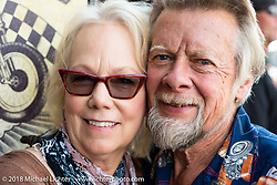 Donna Mauphin and Arlin Fatland in front of their 2-Wheelers store on Main Street celebrating 30 years on Main during the 78th annual Sturgis Motorcycle Rally. Sturgis, SD. USA. Tuesday August 7, 2018. Photography ©2018 Michael Lichter.