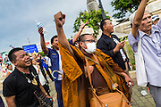 27 MAY 2014 - BANGKOK, THAILAND: A Buddhist monk in Bangkok protests against the coup. Several hundred people protested against the coup in Bangkok at Victory Monument. It was the fourth straight day of pro-democracy rallies in the Thai capital as the army continued to tighten its grip on Thai life. The protest Tuesday was the smallest so far.     PHOTO BY JACK KURTZ