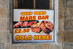 Sign outside takeaway food shop offering deep fried mars bars in Edinburgh, Scotland, UK
