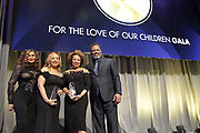 NEW YORK, NEW YORK- FEBRUARY 11: (L-R) Tina Knowles, Cheryl McKissack Daniel (Honoree) and Deryl McKissack (Honoree) and Richard Larson attend the National CARES Mentoring Movement 'FOR THE LOVE OF OUR CHILDREN' Gala Inside held at the Zeigfeld Ballroom on February 11, 2019 in New York City.  (Photo by Terrence Jennings/terrencejennings.com)