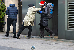 Two British rough sleepers have an altercation on Oxford Street over the site where they seek the help of passing shoppers. Homeless Britons are coming under increasing pressure as a surge of Roma beggars from Romania arrive on the streets of London to take advantage of the generosity of Christmas shoppers. London, December 04 2018.
