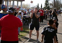 Steve Walls of Taft, Calif., center, prepares to catch a slab of Spam during the Spam toss competition at the 22nd annual Spam Festival, Sunday, Feb. 16, 2019, in Isleton, Calif. Lovers of the processed meat product competed for prizes by presenting their favorite Spam-infused foods, or entering the Spam-eating and Spam-toss contests. (Photo by D. Ross Cameron)