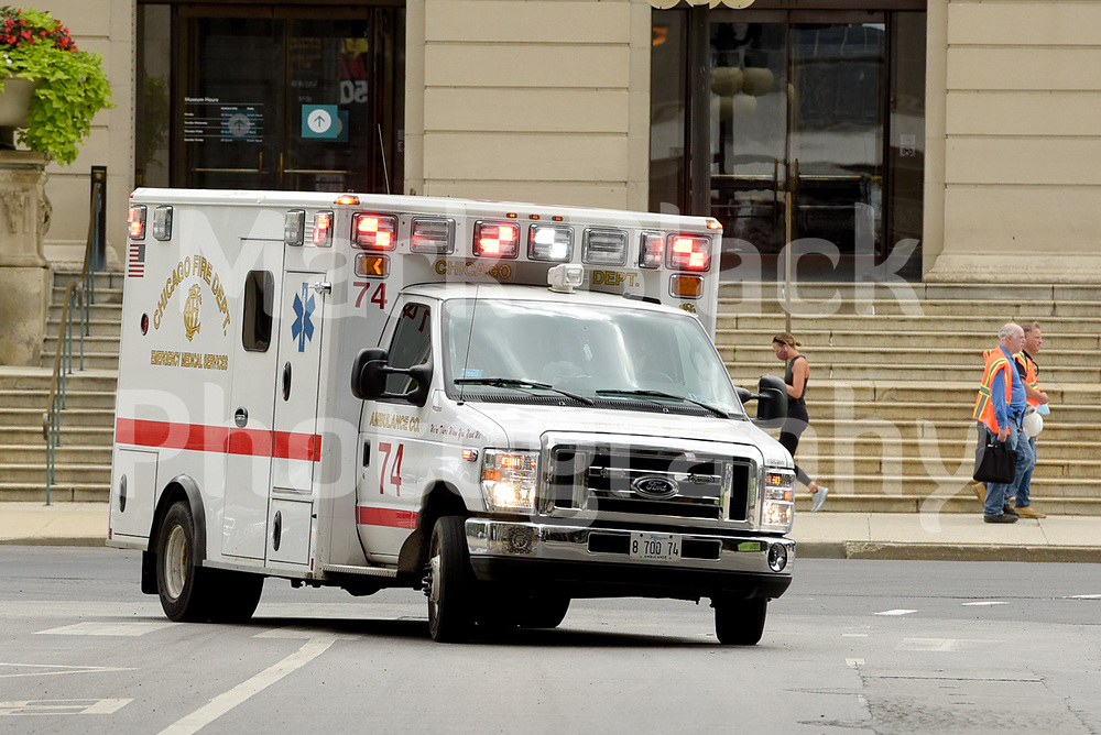Chicago Fire Department ambulance drives along Michigan Avenue in Chicago, Illinois.<br /> Photo by Mark Black