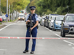 March 15, 2019 - Christchurch, Canterbury, New Zealand - Armed police seal off street to Masjid Al Noor mosque, one of two mosques where gunmen attacked and killed 49 people and another 48 were injured. Four people have been arrested and several bombs were found following the shootings. New Zealand Police have charged a man in his late twenties with murder. NZ authorities have named one of the suspects as Brenton Tarrant. (Credit Image: © PJ Heller/ZUMA Wire)