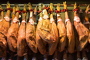 Haunch leg of Iberico Jamon specialty ham in butcher shop Mulas Carnicerias in Salamanca, Spain