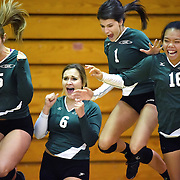 From left, Golden West Rustlers players Megan Sanchez, Madison Koci, Alyson Utke and Kaitlyn Samia celebrate after a game against the Orange Coast Pirates at Orange Coast College on Friday, Nov. 7, 2014. The Rustlers defeated the Pirates in three straight sets. (Timothy Tai/Sports Shooter Academy XI)
