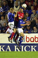 Photo: Richard Lane.<br />Leicester City v Crewe Alexandra. Carling Cup. 23/09/2003.<br />Richard Walker out jumps James Scowcroft and Lilian Nalis.