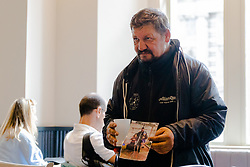 A man holding a picture of his family begs for money in a cafe at Trafalgar Square. Over the last few years London has seen increasing numbers of Eastern European beggars and street performers on its streets as they flock to the UK and other wealthier countries to take advantage of people's generosity. London, August 02 2019.