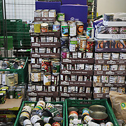 Workers and volunteers at Hackney Foodbank receive and organize food donations, 15th of December 2021, Hackney, East London, United Kingdom. Food ready to be distributed into food parcels. The Hackney Foodbank is part of a nationwide network of foodbanks, supported by The Trussell Trust, working to combat poverty and hunger across the UK. The food bank gives out three days emergency food supplies to families and individual who go hungry in the borrough. The food is all donated by individuals and the food donated is held in a small ware house where it is  sorted and packed for distribution.  More people than ever in Britain have turned to the food bank for help and in Hackney the need has gone up with 350% over the past two years.