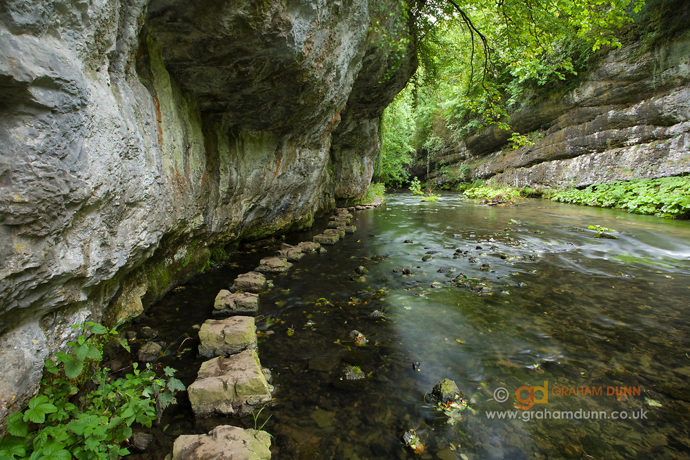 An impressive section of the Chee Dale gorge with its delightful stepping stones and rather ominously overhanging rock. Here the River Wye