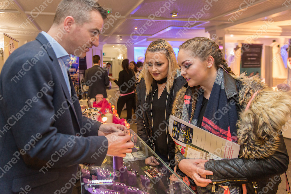 Sheana McGuire and Kayle Halpin from Shannon reviewing the wedding jewellery from Tadgh O' Flynn Jewellers, Ennis