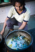 A cook makes a curry at Babu Shahi Bawarchi, New Delhi, India<br /> The famous but modest takeaway housed in the grounds of a shrine is famous for its biryani and whose owners ancestors served as chief cooks under the Moghul Emperor, Shah Jahan