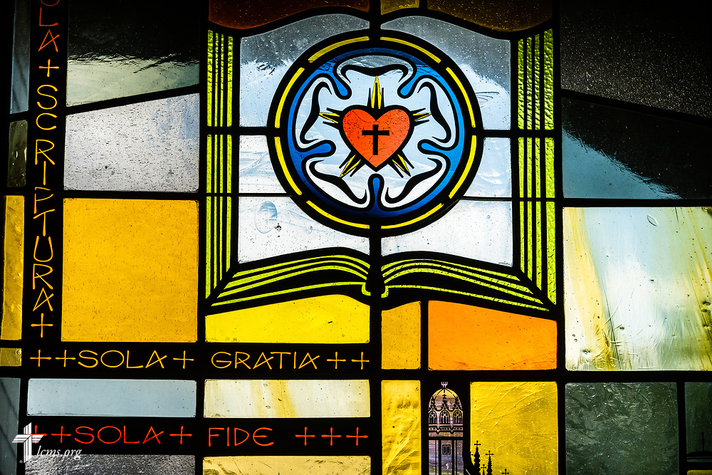 """Stained glass depicting the congregation's solid stance on the Lutheran confessions summarized with """"Scripture Alone, Grace Alone, and Faith Alone,"""" on Sunday, Aug. 2, 2020, at Elm Grove Lutheran Church, Elm Grove, Wis. LCMS Communications/Erik M. Lunsford"""